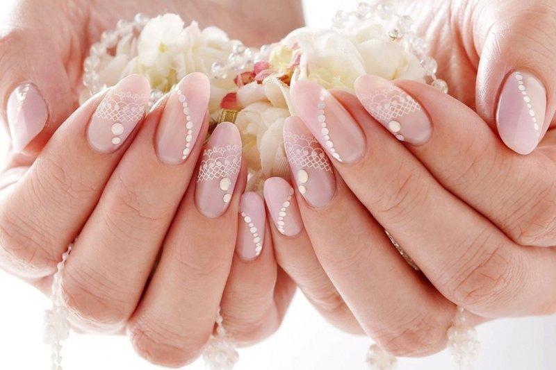 Baby roze bruiloft ontwerp met stippen en kant.