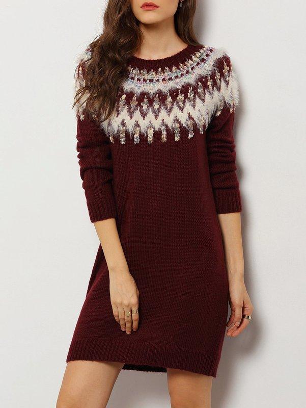 Meisje in etnische trui jurk