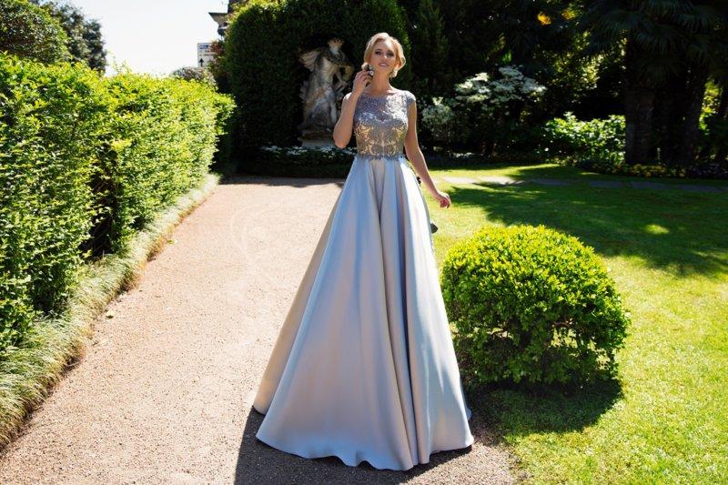 Gevoelige jurk met guipurekant