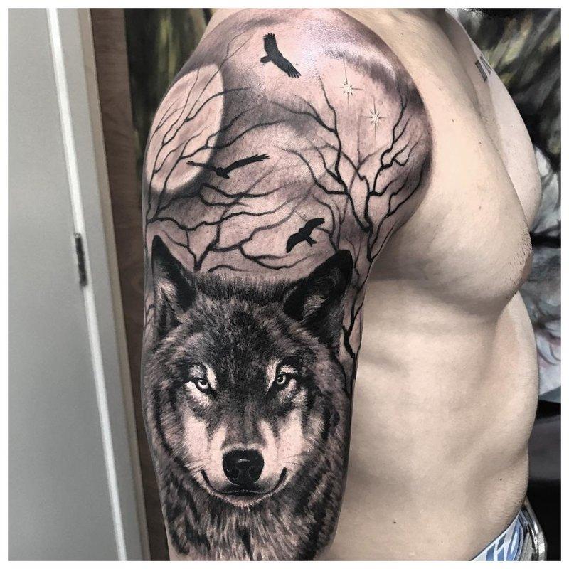 Realistische wolf - tatoeage op de schouder