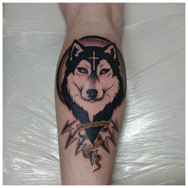 Glimlachende wolf - kuit tattoo