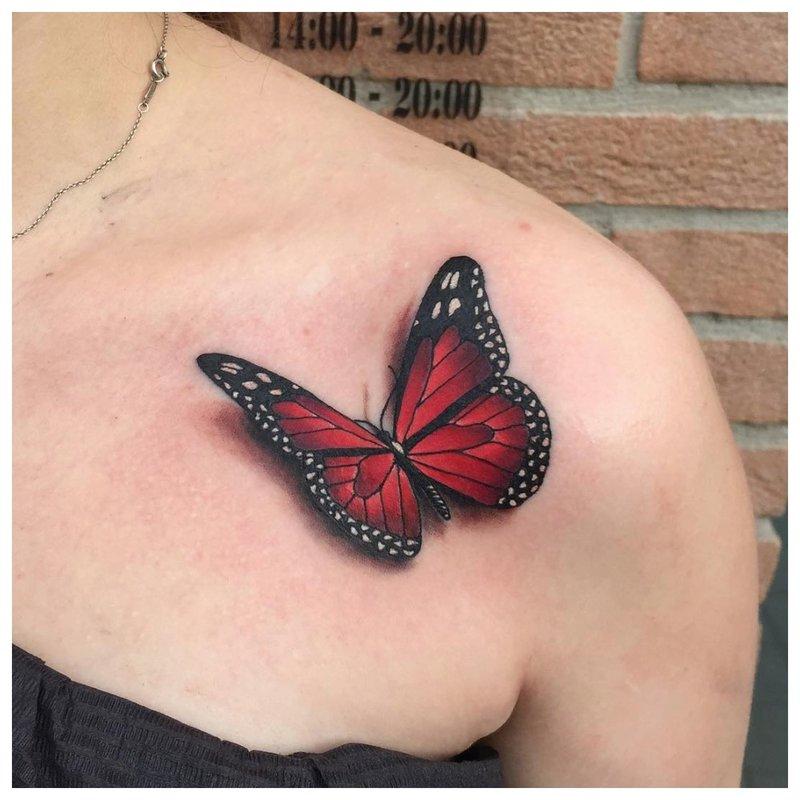 Ryškus drugelis ant apykaklės - tatuiruotė