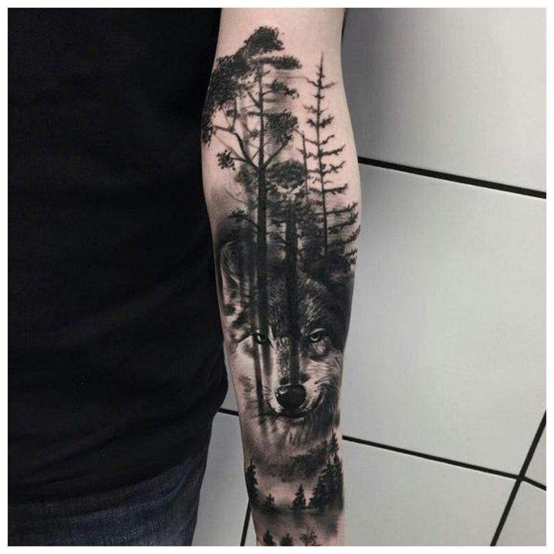 Wolf en boslandschap - tattoo man