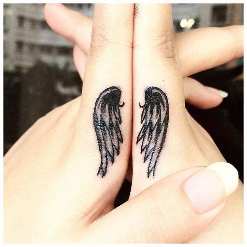 Angelo sparnų tatuiruotė
