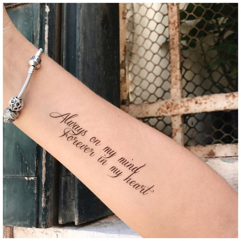 Tvarkingas tatuiruotės užrašas