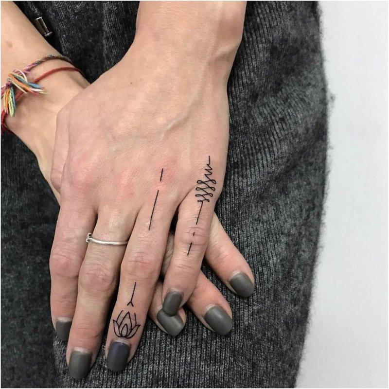Tatuiruotės delnais ir pirštais