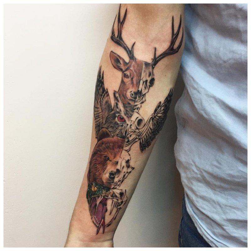 Gyvūno tatuiruotė ant vyro dilbio