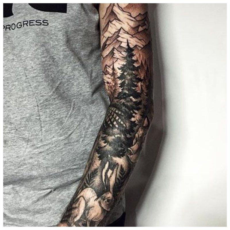Vyriškos rankos tatuiruotė