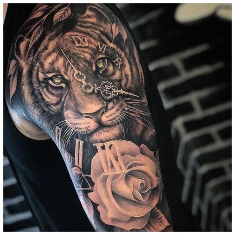 Gyvūno tatuiruotė ant vyro rankos