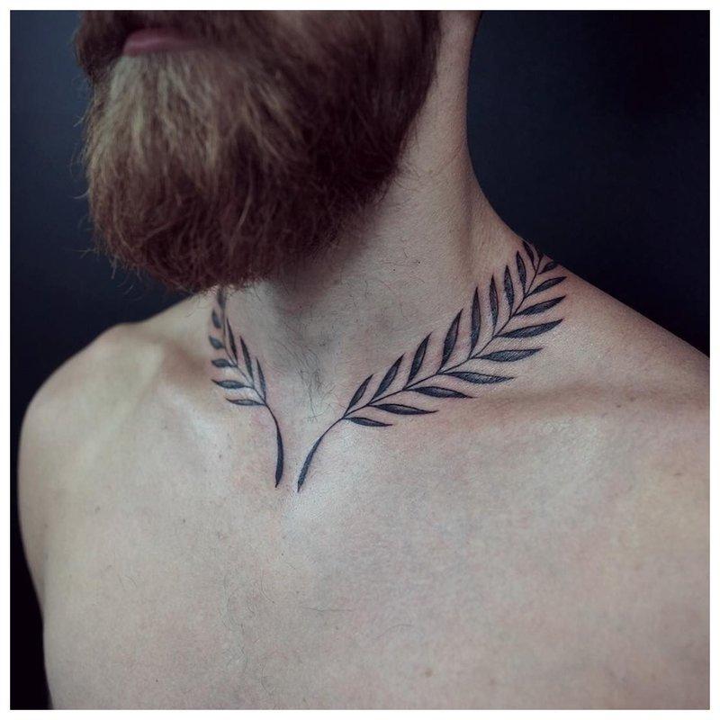 Tatuiruotė 2 šakos ant vyro kaklo