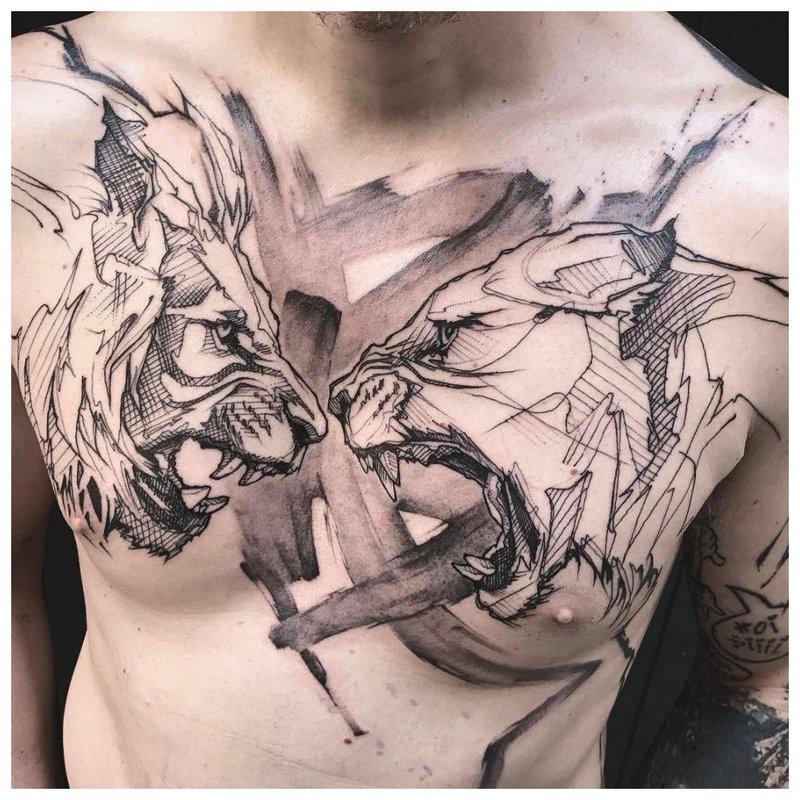 2 boze dieren - een tatoeage op de borst van een man
