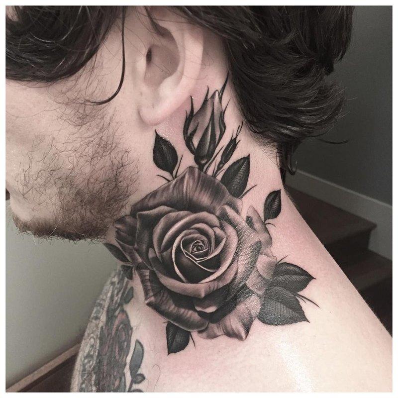 Tatuiruotės rožės ant viso vyro kaklo
