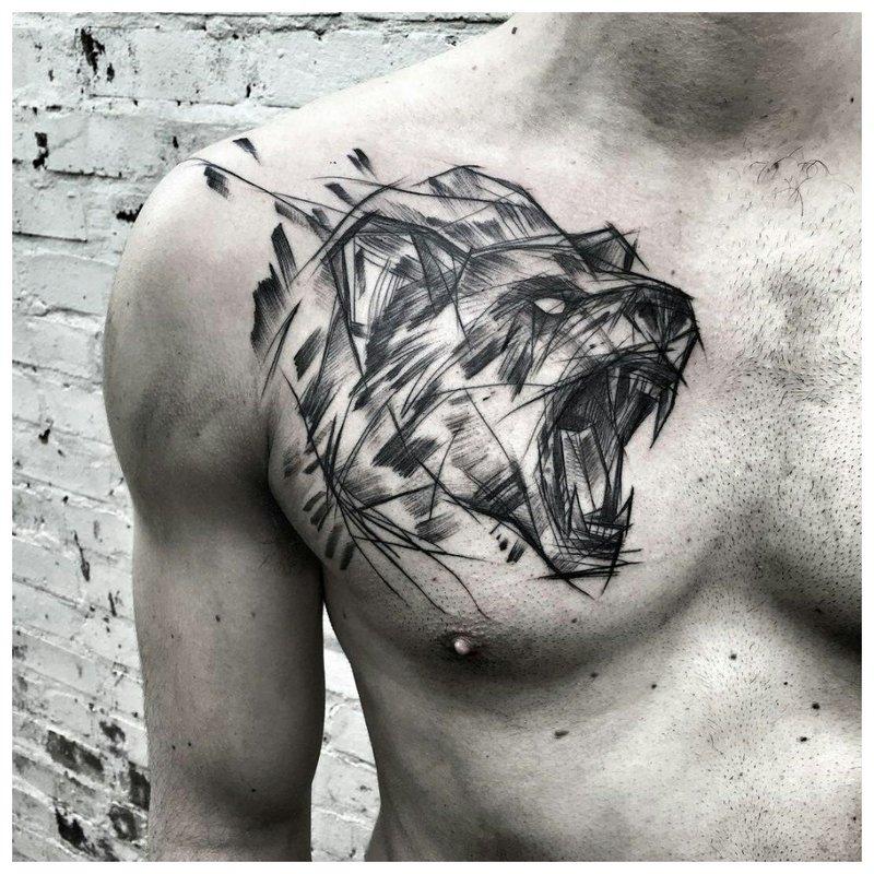 Dier - tatoeage op de borst van een man
